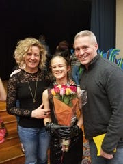 Sixth grade Sadie Kosoff (center) with her parents after a performance.