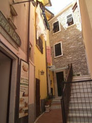 Walking the winding streets of Colonnata is as energetic as hiking its surrounding steep hills.