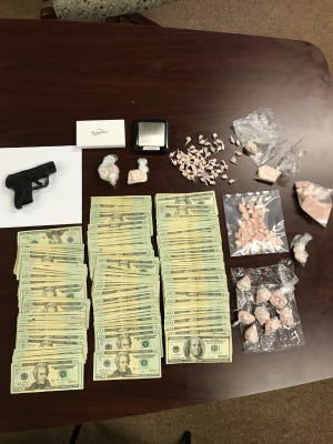 Muncie police said they seized a pound of heroin - believed to be the largest local heroin seizure ever - and arrested three Michigan men in a late Saturday raid. A large amount of cash and a stolen handgun were also confiscated.