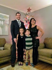Jennifer Millican, right, with her family at Christmas 2017. From left to right, her husband, Michael, 9-year-old Taylor Ann, 7-year-old Leo and Millican