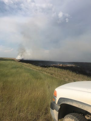 Fire crews battled a blaze 20 miles northeast of Choteau Tuesday. The fire burned around 80 acres but no injuries or structure damage was reported.