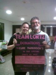 Former Team Lortz leader Denae Moyer and Jim Lortz pose alongside a poster at the Watters Theatre after the Binghamton University's Summer Youth Musical Theatre Workshop production of 'Legally Blonde the Musical' in 2012.