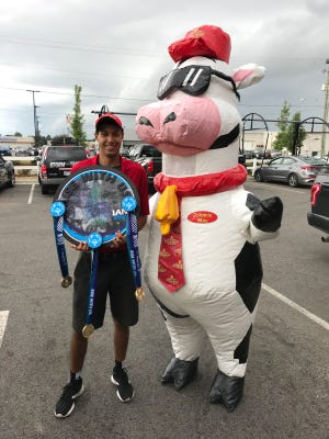 Ian Bussey won three gold medals during the Special Olympics USA Games in Seattle earlier this month while representing the West Licking Warriors. Moo Moo Express Car Wash, Bussey's employer, gave him a surprise celebration Sunday.