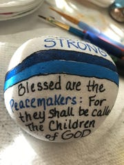 Susette London Lewis painted a rock in honor of injured Fort Myers Officer Adam Jobbers-Miller.