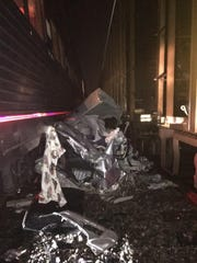 Two Trains Hit Car
