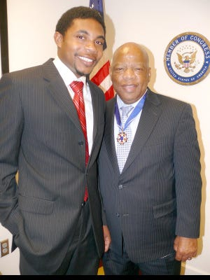 Jonathan Collins, now a professor at Brown University, with Rep. John Lewis, D-Ga., on the day President Barack Obama awarded him the Presidential Medal of Freedom.
