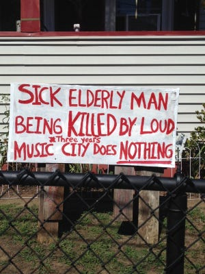 Dorothea Pelletier, who lives on 4th Street in Taunton, put a sign out to complain about her neighbors playing loud music.