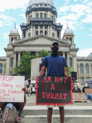 Chadwick Workman, of Springfield, joins several hundred other protesters at the Illinois Statehouse on Monday to speak out against the recent death of George Floyd in Minnesota and countless other African Americans who have been killed by law enforcement around the country.