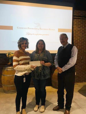 Perfect Fit Foundation president Trista Fergerson and vice president Holly Legg, co-founders of Perfect Fit Foundation, receive a $50,000 grant from the Community Foundation of Southwest Kansas on Nov. 12 in the conference room at Boot Hill Museum.