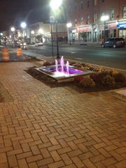 The fountain that has been repaired and restarted as part of the Make A Difference Day project in Bound Brook has been turned pink right now for Breast Cancer Awareness Month.