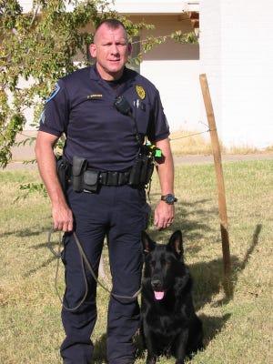 Deuce and Sgt. Chuck Bridges in 2008.