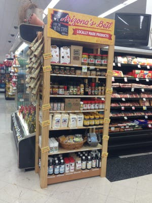 """A Scottsdale Bashas' store near Thompson Peak Parkway and Bell Road is the first to display an """"Arizona-made"""" end cap as part of a new partnership with Local First Arizona. The end-cap went up in June and features 50 products from 16 local vendors."""
