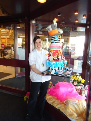 Amanda Hansen of the Sauk Rapids Coborns won gold at the 93rd annual Upper Midwest Bakery Convention with a cake inspired by 'Alice in Wonderland.' It took more than 25 pounds of icing and more than 40 hours to construct.