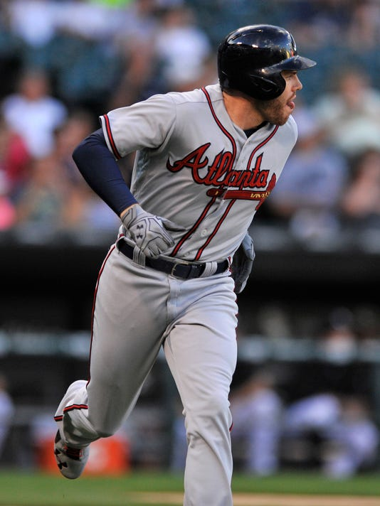 Atlanta Braves' Freddie Freeman watches his solo home run during the first inning a baseball game against the Chicago White Sox, Friday, July 8, 2016, in Chicago. (AP Photo/Paul Beaty)