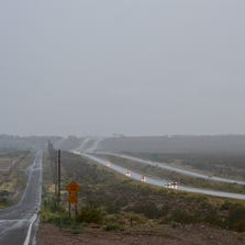 Traffic on Interstate 15 was backed up for miles Tuesday after rains flooded southbound lanes for 30 minutes.