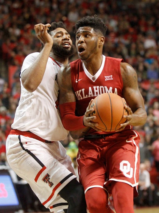 Oklahoma guard Rashard Odomes looks for a shot while defended by Texas Tech forward Aaron Ross during the first half of an NCAA college basketball game Saturday, Feb. 4, 2017, in Lubbock, Texas. (Mark Rogers/Lubbock Avalanche-Journal via AP)