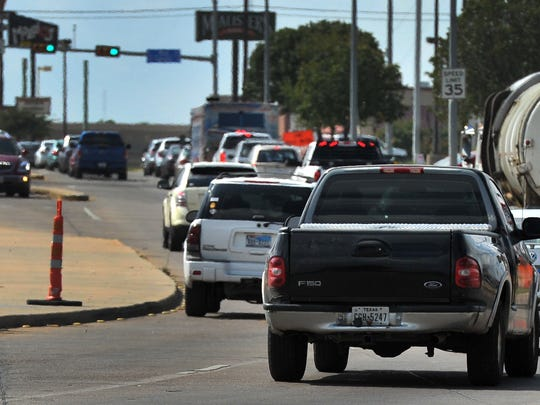 In this file photo, traffic flows to Call Field Road at the intersection of Kemp Boulevard. Council is set to approve a $6.6 million bid for asphalt rehabilitation on several roads throughout the city. A portion of the work will be funded by proceeds from a bond approved in May.