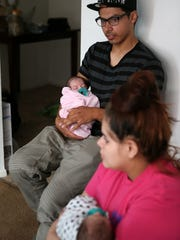 Teen parents Jacob and Angel Mendoza hold their four