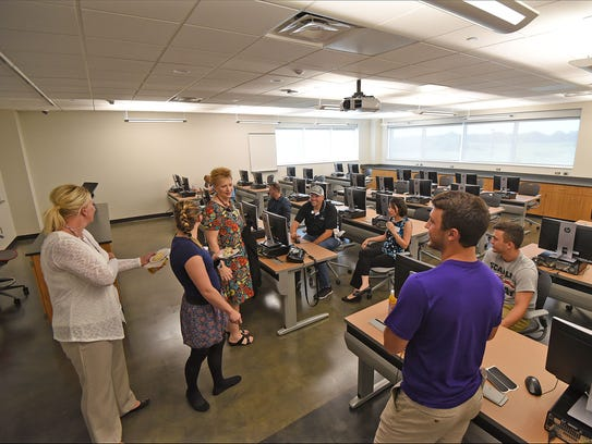 Visitors inspect one of the computer labs in the new