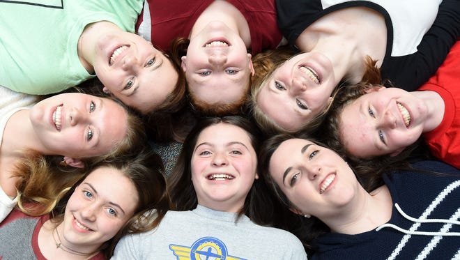 Mentors and mentees in the new BigLil program have fun while having their photograph made on Thursday. Shown, clockwise from bottom center, are: Grace Avants, 13, Mary Stupar, 13, Kaylea Yeakley, 17, Linnsey Dunavan, 16, Autumn McFarland, 12, Rachel Bruton, 18, Madi Feeser, 12, and Madeline Malloy, 17. Turn the photograph around to see the beautiful expressions of all the girls.
