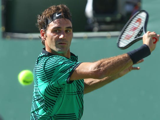 Roger Federer hits a shot during his win over Stan