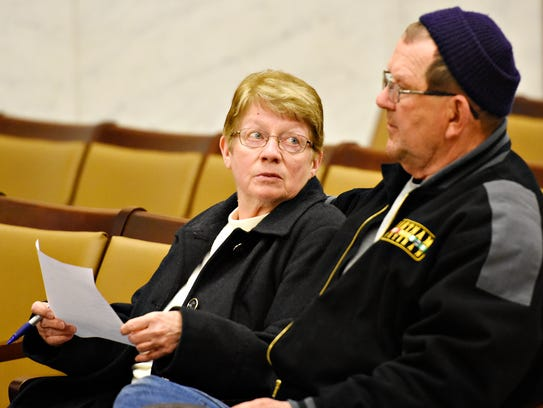 Donetta Landis, 72, left, confers with her husband
