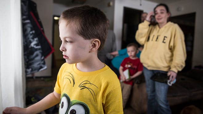 Tristan Stiffler, 6, looks at the snow out the front window of his Hartford City home last week.