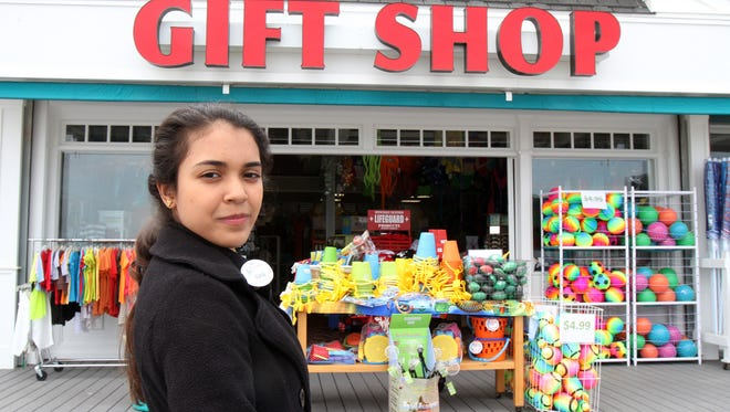Karla Medina of the Dominican Republic talks about working at the gift shop inside Frank's Fun Center on Jenkinson's Boardwalk in Point Pleasant Beach.