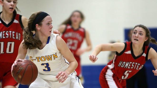 Germantown's Natalie McNeal (3) attempts to get around Homestead's Grace Mueller (10) and Savannah Melan (5) during the teams game in Germantown High School Tuesday, Jan. 31, 2017, in Germantown, Wisconsin.