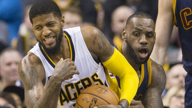 Paul George of Indiana is grabbed by LeBron James during Cleveland Cavaliers at Indiana Pacers, Bankers Life Fieldhouse, Indianapolis, Wednesday, February 8, 2017. Indiana lost 117-132 to the reigning NBA Champions.