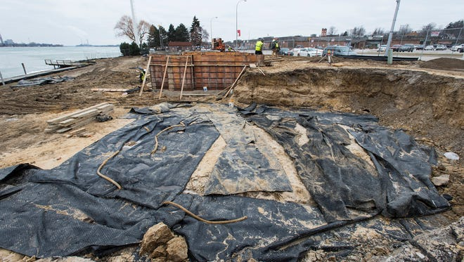 Westhaven Builders construction crews work in the foundation of what will be three new rental cottages outside of the St. Clair Inn Thursday.