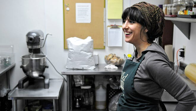 Alicia Landucci talks about her work April 7 as a vegan baker at Good Earth Co-op in St. Cloud. Landucci makes a variety of baked goods including cookies, sweet breads and scones for sale at the store.