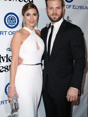 Jamie-Lynn Sigler, left, and Cutter Dykstra arrive at The Art of Elysium's Ninth annual Heaven Gala at 3LABS on Saturday, Jan. 9, 2016, in Culver City, Calif. The two got married at The Parker in Palm Springs on Jan. 16.
