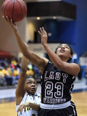 Nanih Waiya's Ashlie Thames hits a layup after getting by Shaw's Tonaria Smith (24) on Thursday in the Class 1A quarterfinals at the Lee E. Williams Athletics & Assembly Center at Jackson State.