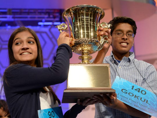 Co-champions Vanya Shivashankar, left, and Gokul Venkatachalam hold the trophy at the 2015 Scripps National Spelling Bee at National Harbor, Md., on May 28, 2015.