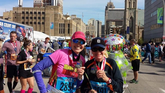 Diane Montgomery celebrates finishing the 2014 Detroit Free Press/Talmer Bank Marathon with her sister, Sarah Anne.