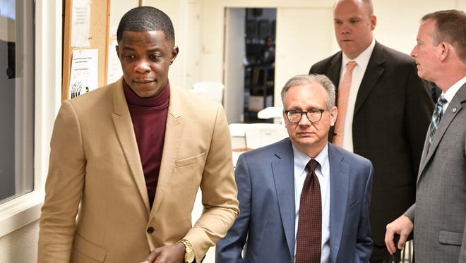 James Shaw Jr., 29, left, walks with Mayor David Briley after church services. Shaw disarmed a shooter at the Antioch Waffle House.  Sunday April 22, 2018, in Nashville, Tenn
