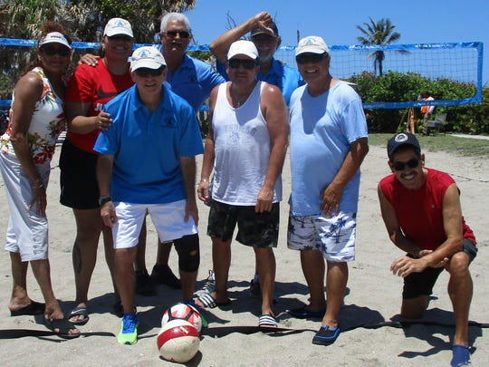 Back row, from left, are Josie Guadalupe, Ariana Guadalupe, Carlos Bonet and Herman Santa; front row, Carlos Mejia, Tony Cruz, Al Feliciano and Al Peñaat pose on the volleyball court at the Jensen Beach Park for the Spanish American Club's annual picnic.