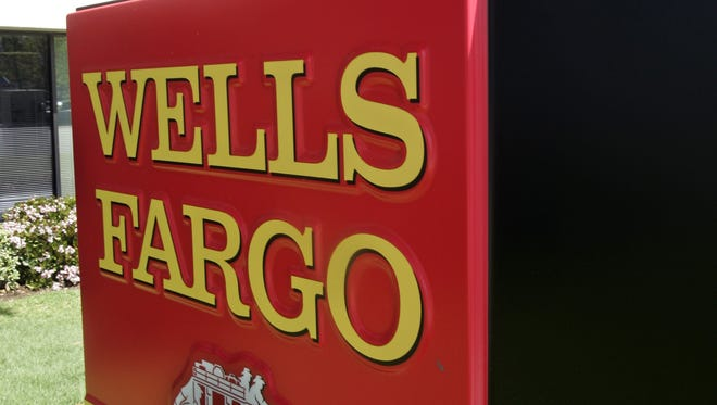 A Wells Fargo Bank sign is seen in front of a branch in Sunnyvale, Calif. in this April 14, 2008 file photo.