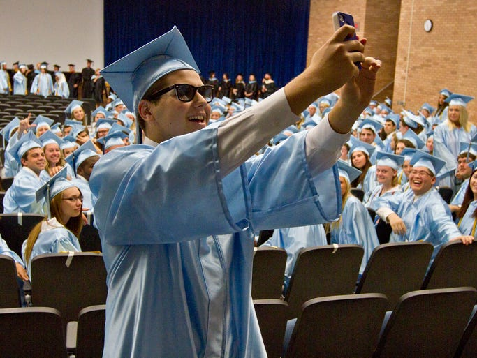 Graduate Tal Zak shoots a selfie with his class in the backround prior to the ceremony. The forty-second annual commencement of Freehold Township High School. Freehold Township, NJ Tuesday, June 24, 2014 Doug Hood/Staff Photographer