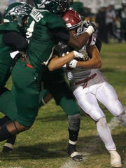 RICHARD QUINN/SPECIAL TO THE STAR Oxnard High tunning back Marquis Allen is smothered by the Pacifica High defense during Friday night's Pacific View League game.