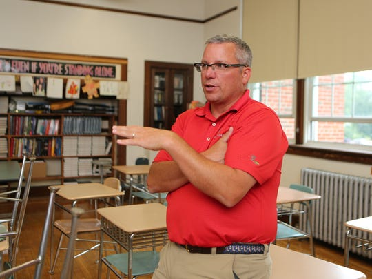 Kevin Budzynski, the department chairperson for social studies at Alexander Hamilton High School in Elmsford, is pictured at the school, Sept. 1, 2016.