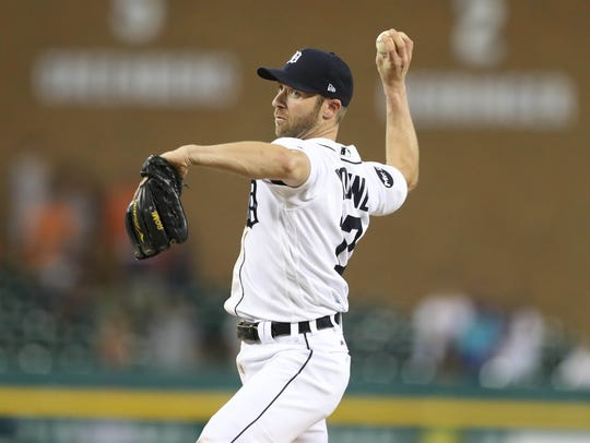 Andrew Romine pitches in the ninth inning of the Tigers'
