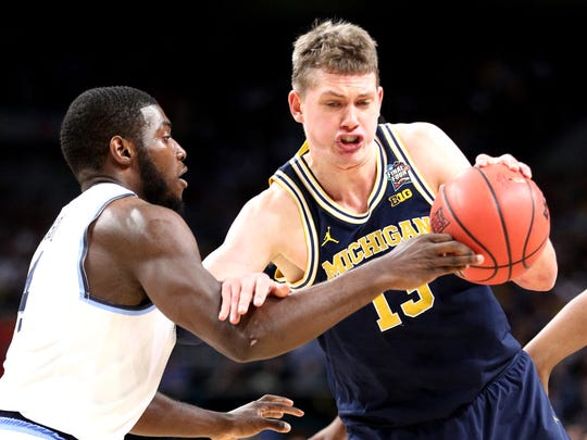 Michigan forward Moritz Wagner (13) drives to the basket