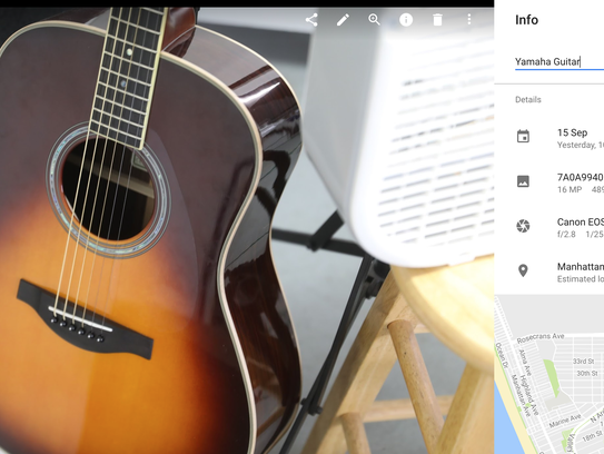 Click the I tab in Google Photos to open up the description