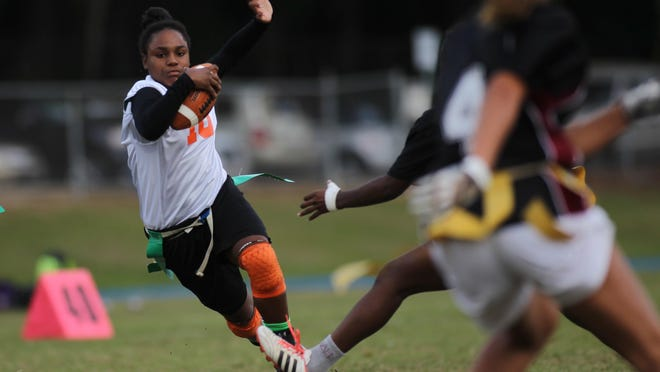 FAMU DRS eighth-grader Erica Turral catches a pass and makes a cut up field during a 20-14 win over Chiles on Monday night at Godby in a district semifinal.