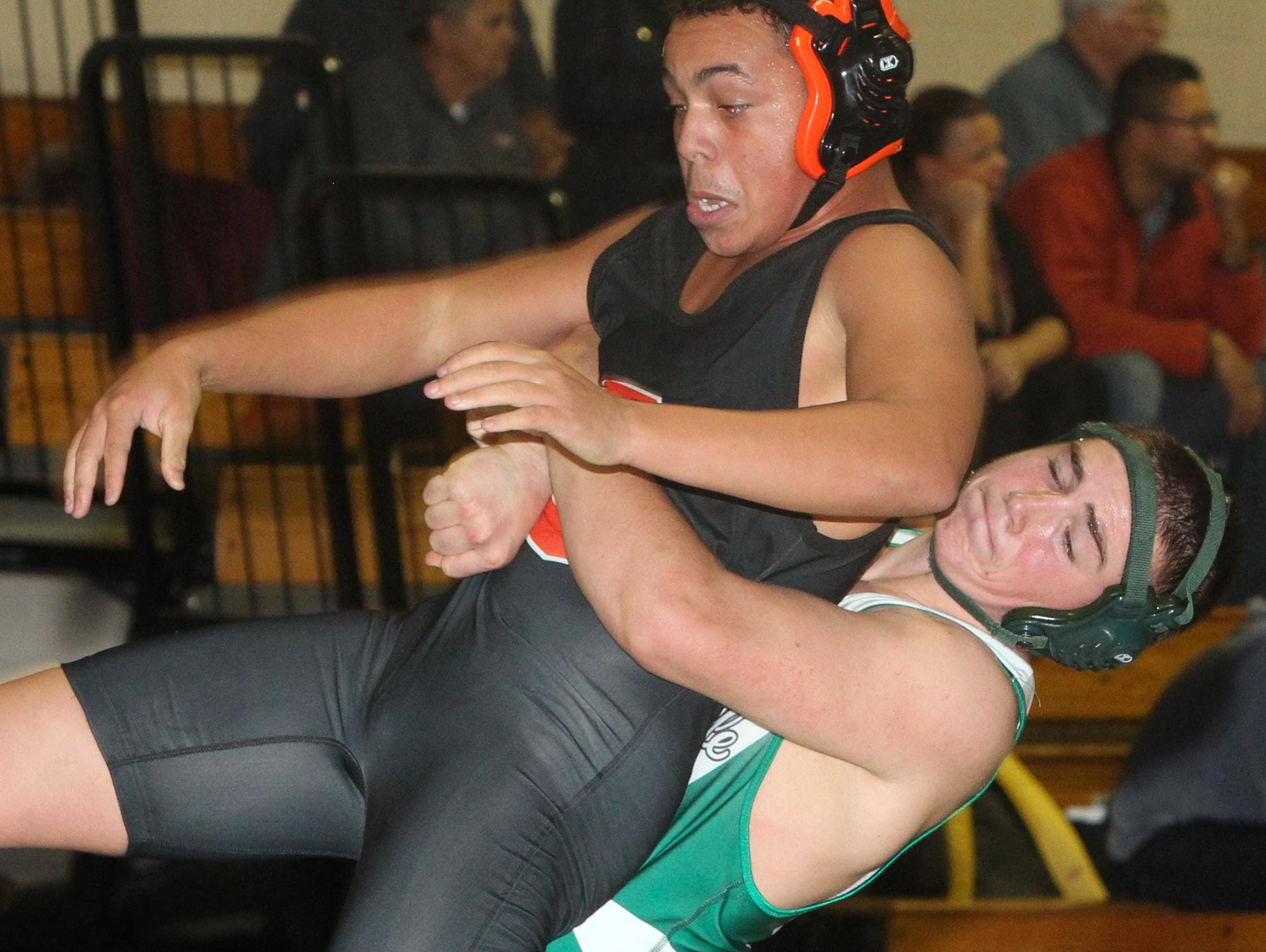 Pleasantville's Nolan Egan, right, pinned Croton's Israel Rocker in the 170-pound final at the Section 1 Dual Meet Championships Division 2 quad meet at Irvington Dec. 1, 2015.