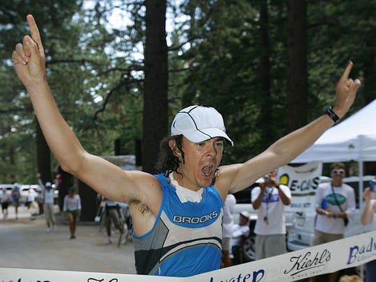 Defending champion Scott Jurek crosses the finish line at Whitney Portal in Lone Pine, California, to win the Kiehl Badwater Ultramarathon July, 25 2006. Jurek travelled by foot 135 miles non-stop from Badwater in Death Valley, the lowest elevation in the Western Hemisphere at 282 feet (85.5 meters) below sea level, to Mt. Whitney Portals at 8,360 feet (2,533 meters) above sea level in 25 hours, 41 minutes and 18 seconds.