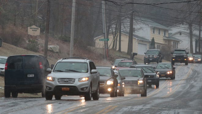Cars snake their way around trapped cars on Westbrook Drive in Cortlandt Manor on Jan. 18, 2015.  Many motorists were stuck on the road due to black ice.