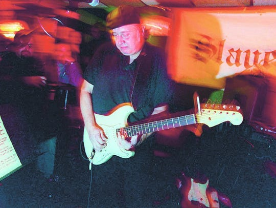 Bernie Brausewetter on stage at The Court Tavern, New